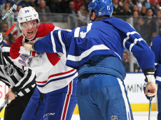TORONTO, ON - JANUARY 7:  Michael McCarron #34 of the Montreal Canadiens dukes it out with Matt Martin #15 of the Toronto Maple Leafs during an NHL game at the Air Canada Centre on January 7, 2017 in Toronto,Ontario, Canada. The Canadiens defeated the Maple Leafs 5-3. (Photo by Claus Andersen/Getty Images)