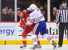 CALGARY, AB - JANUARY 21: Deryk Engelland #29 of the Calgary Flames fights Milan Lucic #27 of the Edmonton Oilers during an NHL game at Scotiabank Saddledome on January 21, 2017 in Calgary, Alberta, Canada. (Photo by Derek Leung/Getty Images)