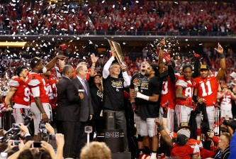ARLINGTON, TX - JANUARY 12:  Head Coach Urban Meyer of the Ohio State Buckeyes hoist the trophy after defeating the Oregon Ducks 42 to 20 in the College Football Playoff National Championship Game at AT&T Stadium on January 12, 2015 in Arlington, Texas.  (Photo by Christian Petersen/Getty Images)