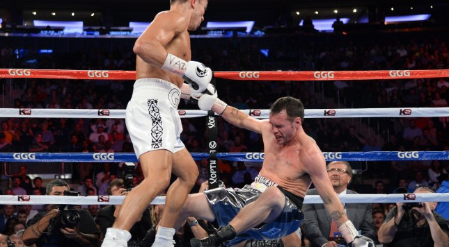 Gennady Golovkin (white gloves) knocks out Daniel Geale (black gloves) during their middleweight championship bout at Madison Square Garden. Credit: Joe Camporeale-USA TODAY Sports