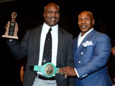 LAS VEGAS, NV - AUGUST 09:  Former boxer Evander Holyfield (L) is inducted into the Nevada Boxing Hall of Fame by former boxer Mike Tyson at the second annual induction gala at the New Tropicana Las Vegas on August 9, 2014 in Las Vegas, Nevada.  (Photo by Ethan Miller/Getty Images)