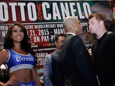 NEW YORK, NY - AUGUST 26:  Miguel Cotto and Canelo Alvarez faceoff during Miguel Cotto Vs Canelo Alvarez Press Conference at Wyndham New Yorker Hotel on August 26, 2015 in New York City.  (Photo by John Lamparski/Getty Images)
