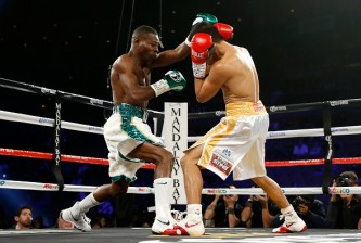 (L-R) Guillermo Rigondeaux throws a right to the face of Drian Francisco during their junior featherweight bout at the Mandalay Bay Events Center on November 21, 2015 in Las Vegas, Nevada.
