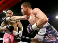 LAS VEGAS, NV - NOVEMBER 21:  (R-L)  Canelo Alvarez throws a right at Miguel Cotto during their middleweight fight at the Mandalay Bay Events Center on November 21, 2015 in Las Vegas, Nevada.  (Photo by Al Bello/Getty Images)