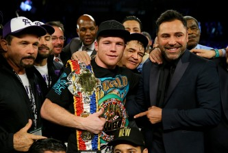 LAS VEGAS, NV - NOVEMBER 21:  Canelo Alvarez celebrates with promoter Oscar De La Hoya after defeating Miguel Cotto by unanimous decision in their middleweight fight at the Mandalay Bay Events Center on November 21, 2015 in Las Vegas, Nevada.  (Photo by Al Bello/Getty Images)
