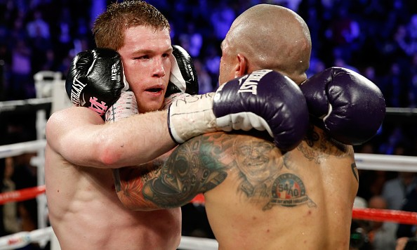 LAS VEGAS, NV - NOVEMBER 21:  Miguel Cotto and Canelo Alvarez embrace after their middleweight fight at the Mandalay Bay Events Center on November 21, 2015 in Las Vegas, Nevada. Alvarez won by unanimous decision.  (Photo by Isaac Brekken/Getty Images)