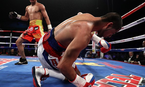 WASHINGTON, DC - MARCH 05: Sadam Ali falls to the mat after taking a punch from Jessie Vargas in their vacant WBO welterweight title match at the DC Armory on March 5, 2016 in Washington, DC. (Photo by Patrick Smith/Getty Images)