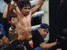 LAS VEGAS, NEVADA - APRIL 09:  Manny Pacquiao celebrates at the end of the 12th round of his welterweight fight against Timothy Bradley Jr. on April 9, 2016 at MGM Grand Garden Arena in Las Vegas, Nevada. Pacquiao won by unanimous decision.  (Photo by Ethan Miller/Getty Images)