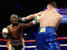 LAS VEGAS, NV - JULY 23:  WBO junior welterweight champion Terence Crawford (L) lands a body shot on WBC champion Viktor Postol of Ukraine during their unification fight at MGM Grand Garden Arena on July 23, 2016 in Las Vegas, Nevada. Crawford won by unanimous decision.  (Photo by Steve Marcus/Getty Images)