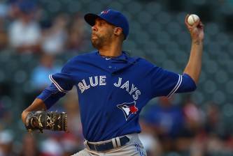 ARLINGTON, TX - AUGUST 26:  David Price #14 of the Toronto Blue Jays pitches against the Texas Rangers in the bottom of the first inning at Globe Life Park in Arlington on August 26, 2015 in Arlington, Texas.  (Photo by Tom Pennington/Getty Images)