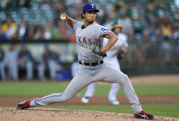 OAKLAND, CA - JUNE 17:  Yu Darvish #11 of the Texas Rangers pitches in the bottom of the second inning against the Oakland Athletics at O.co Coliseum on June 17, 2014 in Oakland, California.  (Photo by Thearon W. Henderson/Getty Images)