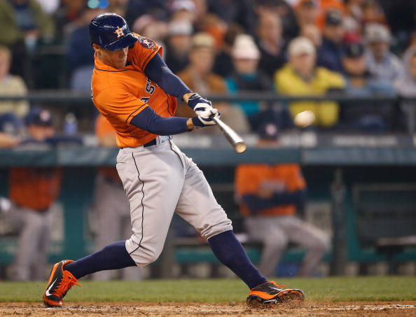 SEATTLE, WA - MAY 25:  George Springer #4 of the Houston Astros hits a two-run home run in the sixth inning against the Seattle Mariners at Safeco Field on May 25, 2014 in Seattle, Washington.  (Photo by Otto Greule Jr/Getty Images)