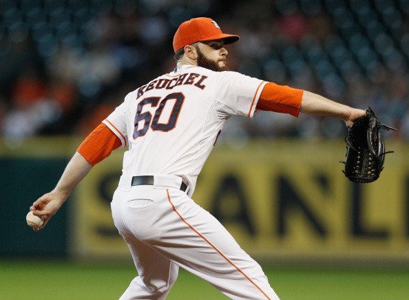 HOUSTON, TX - AUGUST 10:  Dallas Keuchel #60 of the Houston Astros throws in the first inning against the Texas Rangers at Minute Maid Park on August 10, 2014 in Houston, Texas.  (Photo by Bob Levey/Getty Images)