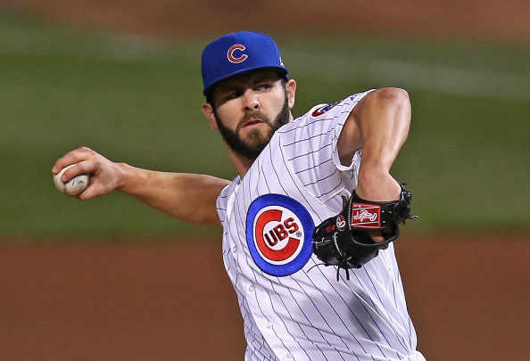 CHICAGO, IL - SEPTEMBER 16:  Starting pitcher Jake Arrieta #49 of the Chicago Cubs delivers the ball against the Cincinnati Reds at Wrigley Field on September 16, 2014 in Chicago, Illinois.  (Photo by Jonathan Daniel/Getty Images)