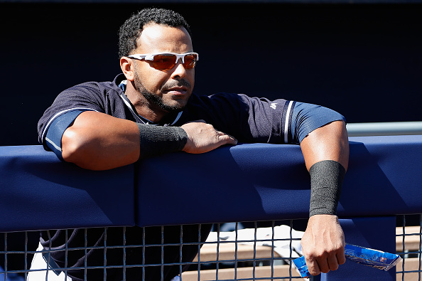 PEORIA, AZ - MARCH 05:  Nelson Cruz #23 of the Seattle Mariners watches from the dugout before the spring training game against the San Diego Padres at Peoria Stadium on March 5, 2015 in Peoria, Arizona.  (Photo by Christian Petersen/Getty Images)