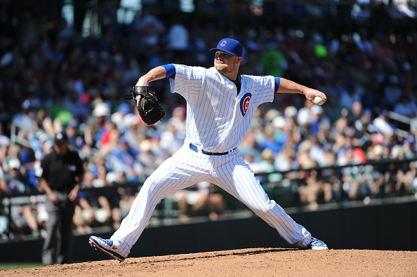 MESA, AZ - MARCH 6: Jon Lester #34 of the Chicago Cubs pitches during the game against the Cincinnati Reds on March 6, 2015 at Sloan Park in Mesa, Arizona. The Reds defeated the Cubs 5-2. (Photo by Rich Pilling/Getty Images)