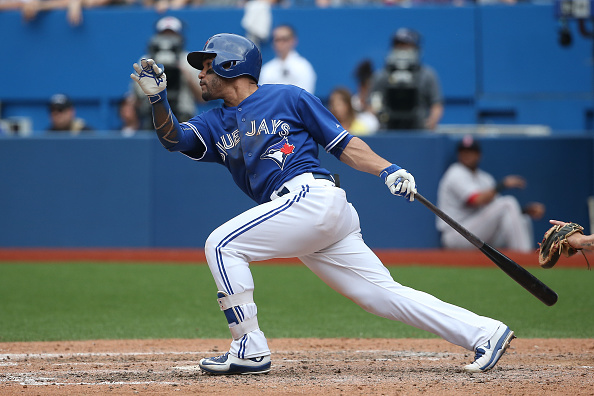 TORONTO, CANADA - MAY 9: Devon Travis #29 of the Toronto Blue Jays hits an RBI single in the seventh inning during MLB game action against the Boston Red Sox on May 9, 2015 at Rogers Centre in Toronto, Ontario, Canada. (Photo by Tom Szczerbowski/Getty Images)