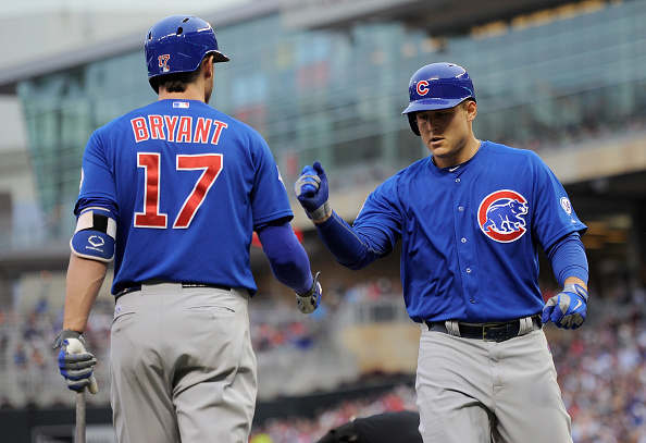 MINNEAPOLIS, MN - JUNE 19: Kris Bryant #17 of the Chicago Cubs congratulates teammate Anthony Rizzo #44 on a solo home run against the Minnesota Twins during the fourth inning of the game on June 19, 2015 at Target Field in Minneapolis, Minnesota. (Photo by Hannah Foslien/Getty Images)