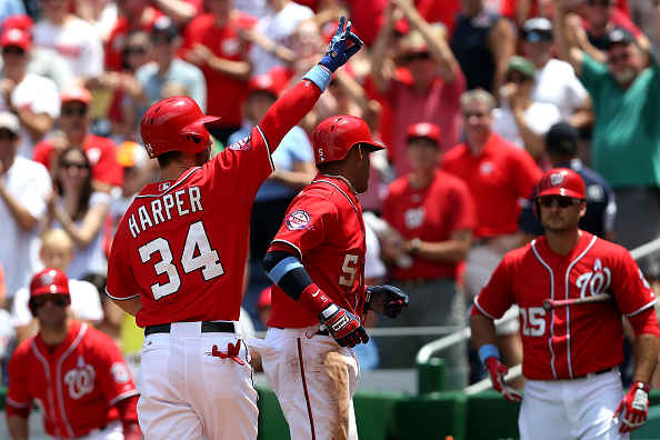 WASHINGTON, DC - JUNE 21: Bryce Harper #34 of the Washington Nationals celebrates after hitting a two run home run in the first inning against the Pittsburgh Pirates at Nationals Park on June 21, 2015 in Washington, DC. (Photo by Patrick Smith/Getty Images)