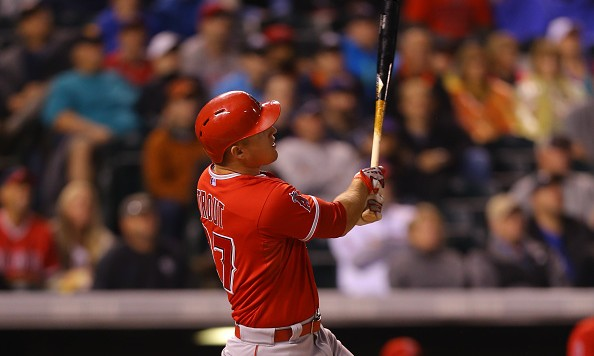 DENVER, CO - JULY 8: Mike Trout #27 of the Los Angeles Angels of Anaheim watches his solo home run in the first inning against the Colorado Rockies during Interleague play at Coors Field on July 8, 2015 in Denver, Colorado. (Photo by Justin Edmonds/Getty Images)