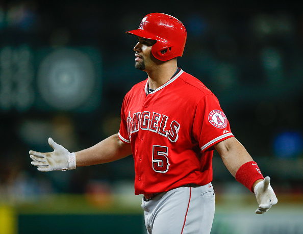SEATTLE, WA - JULY 11: Albert Pujols #5 of the Los Angeles Angels of Anaheim reacts after striking out in the ninth inning against the Seattle Mariners at Safeco Field on July 11, 2015 in Seattle, Washington. The Mariners defeated the Angels 5-0. (Photo by Otto Greule Jr/Getty Images)