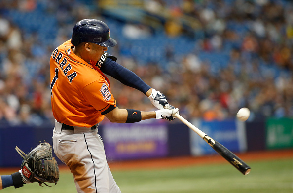 ST. PETERSBURG, FL - JULY 12:  Carlos Correa #1 of the Houston Astros flies out to right field during the fifth inning of a game against the Tampa Bay Rays on July 12, 2015 at Tropicana Field in St. Petersburg, Florida.  (Photo by Brian Blanco/Getty Images)