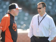 BALTIMORE, MD - JUNE 24:  Executive Vice-President of Baseball Operations Dan Duquette and manager Buck Showalter #26 of the Baltimore Orioles talk before a baseball game against the Chicago White Sox on June 24, 2014 at Oriole Park at Camden Yards in Baltimore, Maryland.  (Photo by Mitchell Layton/Getty Images)