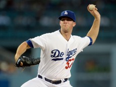 LOS ANGELES, CA - AUGUST 14:  Pitcher Alex Wood #57 of the Los Angeles Dodgers throws against the Cincinnati Reds during the second inning at Dodger Stadium August 14, 2015 in Los Angeles, California. (Photo by Kevork Djansezian/Getty Images)
