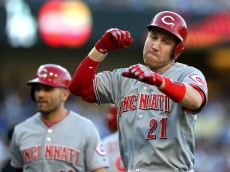 LOS ANGELES, CA - AUGUST 15:  Todd Frazier #21 of the Cincinnati Reds celebrates as he returns to the dugout after hitting a two run home run in the first inning against the Los Angeles Dodgers at Dodger Stadium on August 15, 2015 in Los Angeles, California.  (Photo by Stephen Dunn/Getty Images)