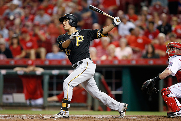 CINCINNATI, OH - SEPTEMBER 9: Jung Ho Kang #27 of the Pittsburgh Pirates follows through on a grand slam home run in the sixth inning against the Cincinnati Reds at Great American Ball Park on September 9, 2015 in Cincinnati, Ohio. (Photo by Joe Robbins/Getty Images)