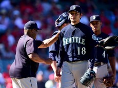 ANAHEIM, CA - SEPTEMBER 27:  Hisashi Iwakuma #18 of the Seattle Mariners reacts as he is removed from the game during the eighth inning against the Los Angeles Angels at Angel Stadium of Anaheim on September 27, 2015 in Anaheim, California.  (Photo by Harry How/Getty Images)