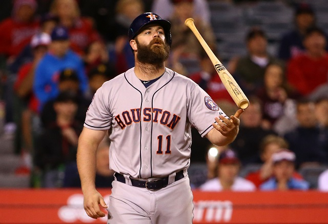 ANAHEIM, CA - MAY 07: Evan Gattis #11 of the Houston Astros tosses his bat after striking out in the eighth inning during the MLB game against the Los Angeles Angels of Anaheim at Angel Stadium of Anaheim on May 7, 2015 in Anaheim, California. (Photo by Victor Decolongon/Getty Images)