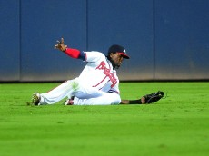 ATLANTA, GA - OCTOBER 2: Cameron Maybin #22 of the Atlanta Braves makes a sixth inning sliding catch against the St. Louis Cardinals at Turner Field on October 2, 2015 in Atlanta, Georgia. (Photo by Scott Cunningham/Getty Images)