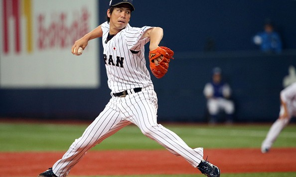 OSAKA, JAPAN - NOVEMBER 12:  Starting pitcher Kenta Maeda #18 of the Samurai Japan pitches in the first inning during the Game one of Samurai Japan and MLB All Stars at Kyocera Dome Osaka on November 12, 2014 in Osaka, Japan.  (Photo by Atsushi Tomura/Getty Images)