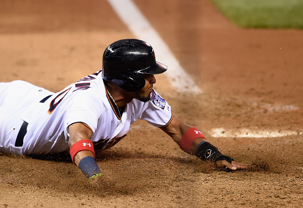 MINNEAPOLIS, MN - JULY 30: Eddie Rosario #20 of the Minnesota Twins slides across home plate to score a run against the Seattle Mariners during the fifth inning of the game on July 30, 2015 at Target Field in Minneapolis, Minnesota. The Twins defeated the Mariners 9-5. (Photo by Hannah Foslien/Getty Images)