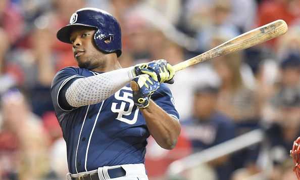 WASHINGTON, DC - AUGUST 26:  Justin Upton #10 of the San Diego Padres hits a solo home run in the seventh inning during a baseball game against the Washington Nationals at Nationals Park on August 26, 2015 in Washington, DC.  The Padres won 6-5.  (Photo by Mitchell Layton/Getty Images)