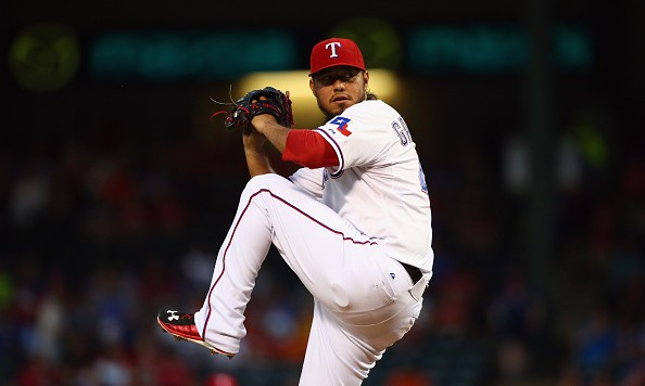 ARLINGTON, TX - SEPTEMBER 30:  Yovani Gallardo #49 of the Texas Rangers throws against the Detroit Tigers in the first inning at Globe Life Park in Arlington on September 30, 2015 in Arlington, Texas.  (Photo by Ronald Martinez/Getty Images)
