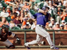 SAN FRANCISCO, CA - OCTOBER 4:  Corey Dickerson #6 of the Colorado Rockies follows through on a three-run home run to break open the game against the San Francisco Giants in the ninth inning at AT&T Park on October 4, 2015 in San Francisco, California, during the final day of the regular season.  The Rockies won 7-3. (Photo by Brian Bahr/Getty Images)