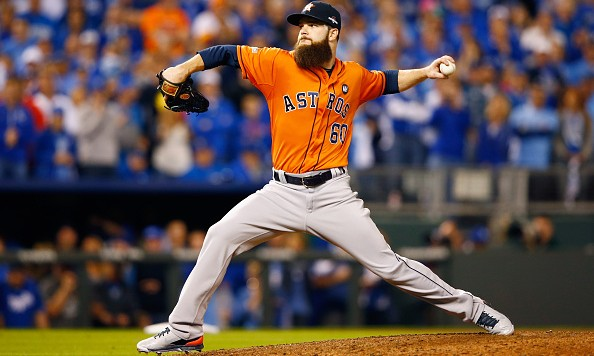 KANSAS CITY, MO - OCTOBER 14:  Dallas Keuchel #60 of the Houston Astros throws a pitch in the eighth inning against the Kansas City Royals during game five of the American League Divison Series at Kauffman Stadium on October 14, 2015 in Kansas City, Missouri.  (Photo by Jamie Squire/Getty Images)