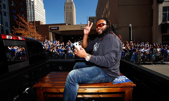 KANSAS CITY, MO - NOVEMBER 03:  Johnny Cueto #47 of the Kansas City Royals waves to the crowd during a parade and celebration in honor of the Royals' World Series win on November 3, 2015 in Kansas City, Missouri.  (Photo by Jamie Squire/Getty Images)