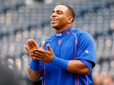 KANSAS CITY, MO - OCTOBER 26: Yoenis Cespedes #52 of the New York Mets claps during the Mets workout the day before Game 1 of the 2015 World Series between the Kansas City Royals and Mets at Kauffman Stadium on October 26, 2015 in Kansas City, Missouri. (Photo by Maxx Wolfson/Getty Images)