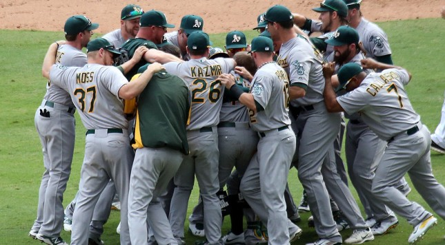 ARLINGTON, TX - SEPTEMBER 28: Oakland Athletics run to the field after securing a playoff spot beating the Texas Rangers 4-0 at Globe Life Park in Arlington on September 28, 2014 in Arlington, Texas.  (Photo by Rick Yeatts/Getty Images)