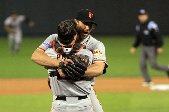 KANSAS CITY, MO - OCTOBER 29:  Buster Posey #28 and Madison Bumgarner #40 of the San Francisco Giants celebrate after defeating the Kansas City Royals to win Game Seven of the 2014 World Series by a score of 3-2 at Kauffman Stadium on October 29, 2014 in Kansas City, Missouri.  (Photo by Alex Trautwig/Getty Images)