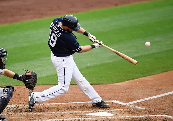SAN DIEGO, CA - JULY 18:  Austin Hedges #18 of the San Diego Padres hits a solo home run during the third inning of a baseball game against the Colorado Rockies at Petco Park July 18, 2015 in San Diego, California.  (Photo by Denis Poroy/Getty Images)