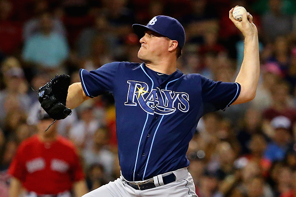 BOSTON, MA - JULY 31:  Jake McGee #57 of the Tampa Bay Rays pitches against the Boston Red Sox during the seventh inning at Fenway Park on July 31, 2015 in Boston, Massachusetts.  (Photo by Maddie Meyer/Getty Images)