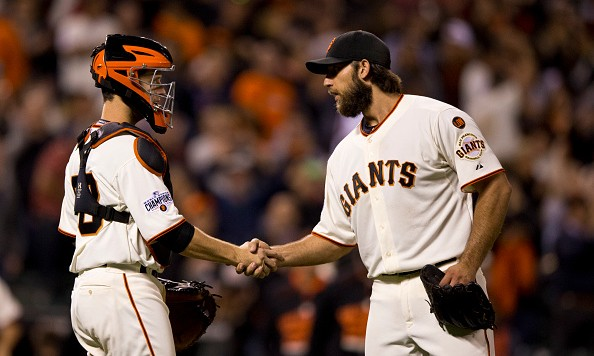 SAN FRANCISCO, CA - AUGUST 11:  Madison Bumgarner #40 of the San Francisco Giants shakes hands with Buster Posey #28 after the game against the Houston Astros at AT&T Park on August 11, 2015 in San Francisco, California.  The San Francisco Giants defeated the Houston Astros 3-1. (Photo by Jason O. Watson/Getty Images)
