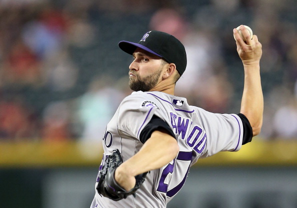 PHOENIX, AZ - APRIL 29:  Starting pitcher Tyler Chatwood #27 of the Colorado Rockies pitches against the Arizona Diamondbacks during the MLB game at Chase Field on April 29, 2014 in Phoenix, Arizona.  (Photo by Christian Petersen/Getty Images)
