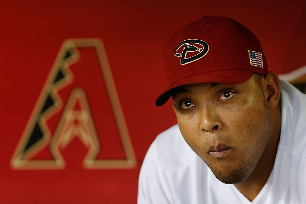 PHOENIX, AZ - SEPTEMBER 11: Yasmany Tomas #24 of the Arizona Diamondbacks sits in the dugout during the MLB game against the Los Angeles Dodgers at Chase Field on September 11, 2015 in Phoenix, Arizona. (Photo by Christian Petersen/Getty Images)