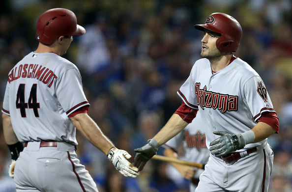 LOS ANGELES, CA - SEPTEMBER 22: A.J. Pollock #11 of the Arizona Diamondbacks is greeted by Paul Goldschmidt #44 as he returns to the dugout after hitting a solo home run in the seventh inning against the Los Angeles Dodgers at Dodger Stadium on September 22, 2015 in Los Angeles, California. (Photo by Stephen Dunn/Getty Images)