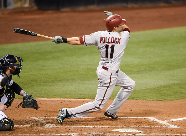 SAN DIEGO, CA - SEPTEMBER 25:  A.J. Pollock #11 of the Arizona Diamondbacks hits a grand slam during the second inning of a baseball game against the San Diego Padres at Petco Park September 25, 2015 in San Diego, California.  (Photo by Denis Poroy/Getty Images)